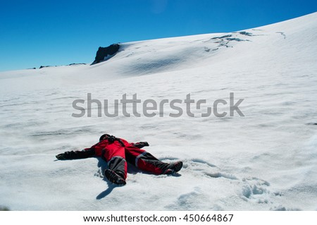 Iceland: relaxing on the snow of Skaftafellsjokull on August 19, 2012. The Skaftafellsjokull, Skaftafell Glacier, is a spur of the Vatnajokull ice cap, which is the largest ice cap in Iceland