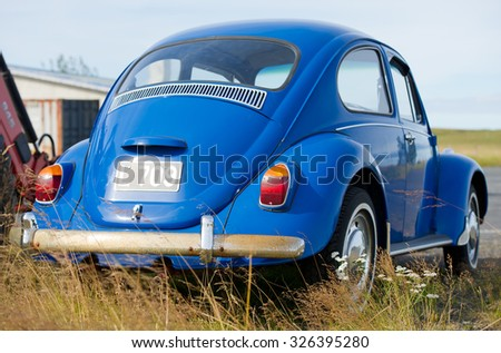 ICELAND-SEP 16, 2015: Volkswagen Beetle - Kaefer - Bug retro car. The Volkswagen Beetle is a two-door, four passenger, rear-engine economy car manufactured and marketed by German automaker Volkswagen. - stock photo