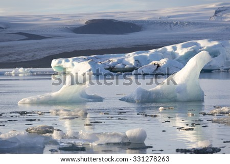 Iceland, sunset over Jokulsarlon Glacier Lagoon, Icebergs floating with the last light, amazing outdoor landscape.