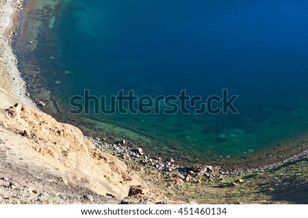 Iceland: the water of Viti lake on August 28, 2012. Viti is an explosion crater formed in 1734 by a massive eruption in the Krafla volcano, its diameter is 300 meters and it has a green lake inside it - stock photo
