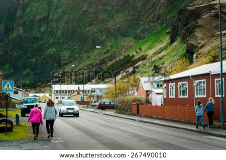 Iceland village city in mountains street road - stock photo