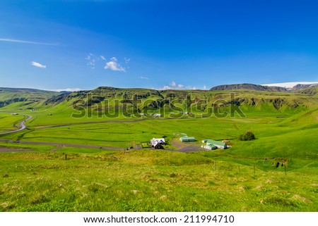 Icelandic farm house in the grassland landscape of Iceland