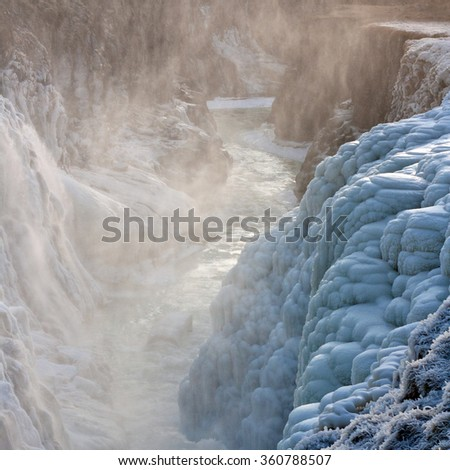 Icelandic Gullfoss waterfall is covered by ice at winter. Close view.