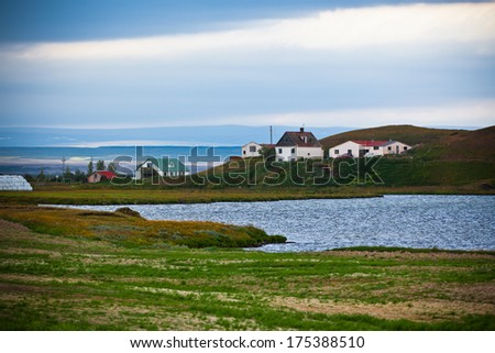 Icelandic Landscape with Small Location at Fjord Coastline. Horizontal shot - stock photo