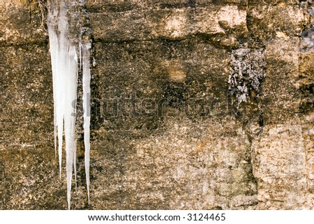 icicle hanging from rock face