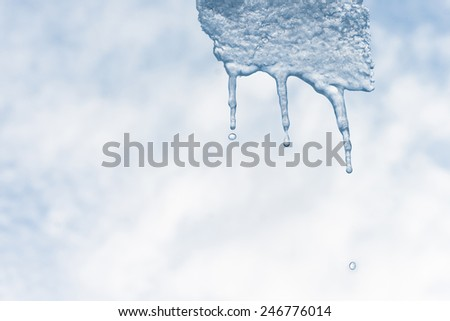 Icicle with water drops falling - stock photo