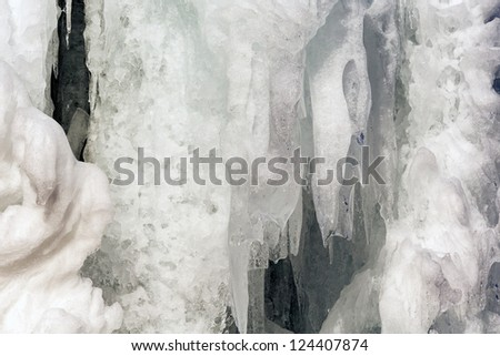 Icicles and chunks of ice covered the whole spruce creating a natural ice sculpture - stock photo