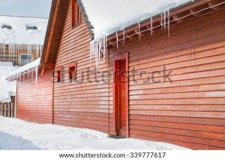 Icicles and snow on an old wooden cottage, Donovaly, Slovakia