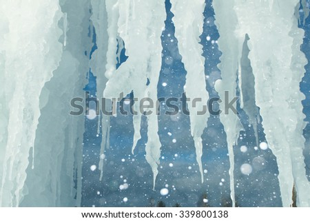 Icicles frozen water. Large floes. Winter background. Copy space. - stock photo