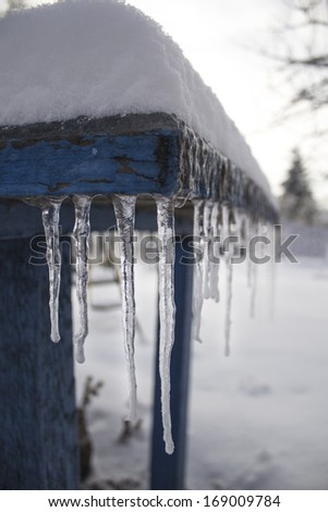 Icicles hang from the table - stock photo