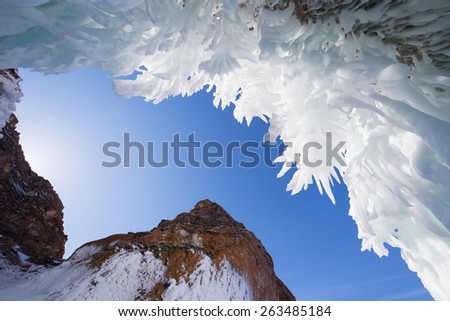 Icicles in the ice cave, Lake Baikal in winter - stock photo