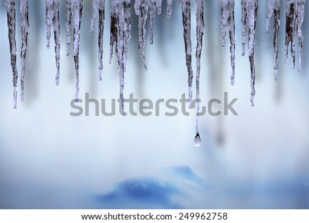 Icicles on blue, pink and and purple ice background - stock photo