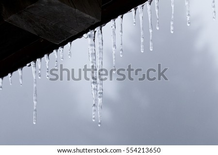Icicles on the edge of the roof