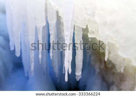 Icicles on the ice, sea a block of ice on the sea, ice in the icicles, winter, Arctic aquatic nature, the ice floe in the ocean, melting of ice.  - stock photo