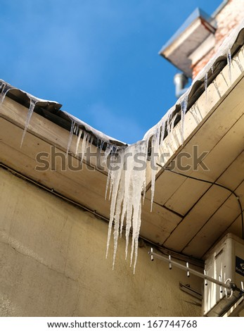 icicles on the roof - stock photo
