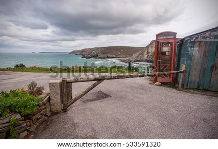 Iconic British Red Phone Box in a remote landscape. Photo taken in Cornwall, England.