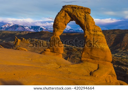 Iconic Delicate Arch in Arches National Park scenic landscape view red orange rock - stock photo