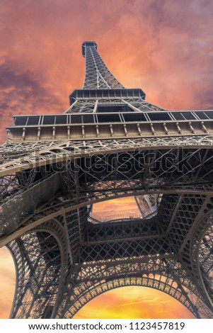 Iconic Landmark Steel Structure of Eiffel Tower in Paris France and Colorful Sunset Sky and Clouds