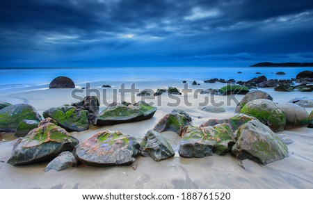Iconic rock of Moeraki Boulders, during cloudy morning, South Island, New Zealand - stock photo