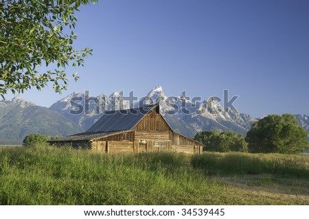 iconic scene of old Mormon barn (circa 1880's) on Mormon Row in the Teton National park - stock photo