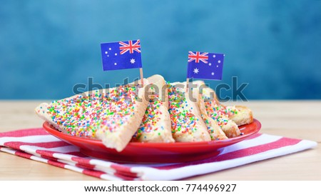 Iconic traditional Australian party food, Fairy Bread, on a red, white and blue background.