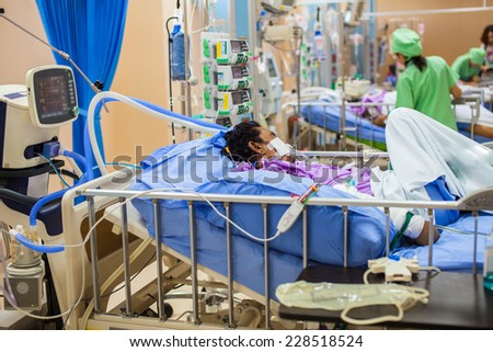 ICU room in a hospital with medical equipments and patient - stock photo