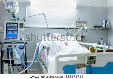 ICU room in a hospital with medical equipments and patient