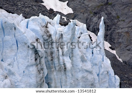 Icy blue Portage Glacier spike Crystal with Rock, Anchorage, Alaska - stock photo