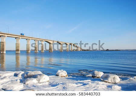 Icy coast by the Oland Bridge in Sweden, one of the longest bridges in Europe. The bridge is connecting the swedish island Oland with mainland Sweden.