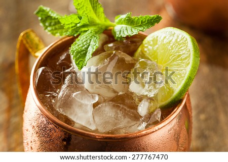 Icy Cold Moscow Mules with Ginger Beer and Vodka - stock photo