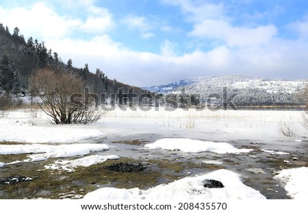 icy lake in winter - stock photo