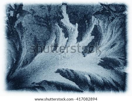 Icy pattern on frozen window. - stock photo