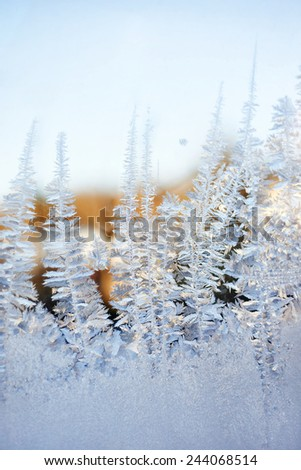 Icy pattern on glass in winter - stock photo