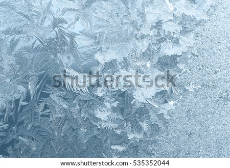 Icy pattern on window glass in frosty day
