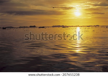 Icy Waters at Sunset - stock photo