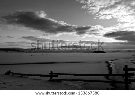 icy winter lake in black and white- calm bulgarian nature