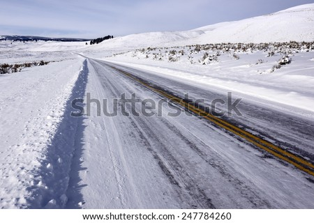 Icy Winter Road in Yellowstone National Park. - stock photo