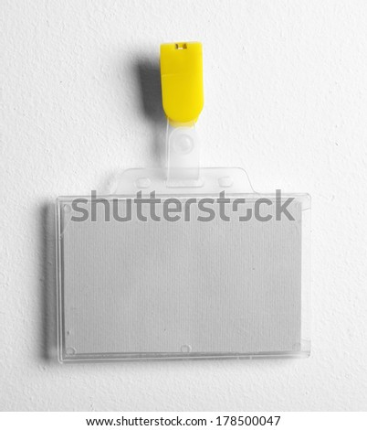 Id badge on white wall