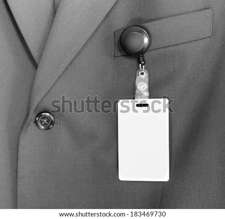 ID Card on a business suite - stock photo