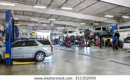 Idaho Falls, Idaho, USA Oct. 8, 2015 A mechanic working on a car in a a modern automotive repair shop. - stock photo