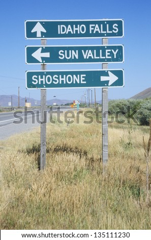 Idaho Falls; Sun Valley ; Shoshone road sign along a highway - stock photo