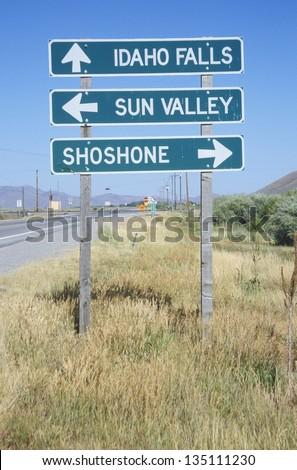Idaho Falls; Sun Valley ; Shoshone road sign along a highway - stock photo