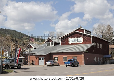 Idaho Springs, CO, USA - April 21, 2014: Large Visitors Center and Heritage Museum also has information about its county, Clear Creek. Inside the building has many historical displays, maps and more. - stock photo