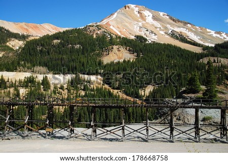 Idarado mine trestle, Genessee mine, Vanderbilt mine and Red Mountain n°3 in the background, near Ouray and Silverton, CO, USA. The Idarado mine was founded in 1939 to extract lead, copper, zinc ore.  - stock photo