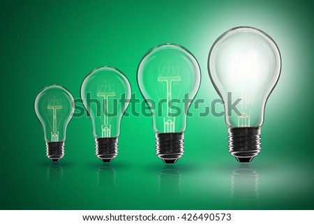 Idea and  leadership concept -  incandescent light bulb on the color background