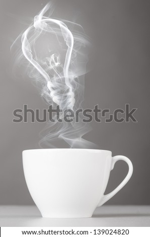 idea. bulb silhouette from steaming hot coffee cup - stock photo