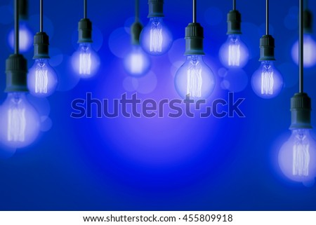 Idea concept background with light bulb in blue gradient background - stock photo