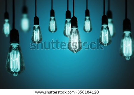 Idea concept background with light bulb in cool tone.  - stock photo
