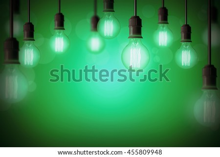 Idea concept background with light bulb in green gradient background - stock photo