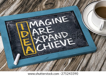 idea concept: imagine dare expand achieve handwritten on blackboard